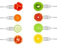 Frutta e verdure sulle forcelle Fotografie Stock