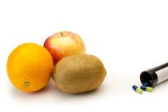 Frutta o farmacia Immagini Stock