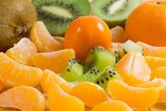 frutta Primo piano del kiwi e del mandarino Fotografia Stock