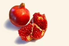 Frutta rossa del melograno ed i suoi semi rossi Fotografia Stock