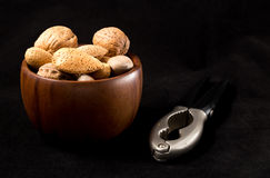 Frutta secca. Fruit bowl with nuts and nutcracker Stock Images