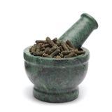 Frutta secca organica del pepe lungo & x28; Longum& x29 del pifferaio; sul pestello di marmo Fotografie Stock