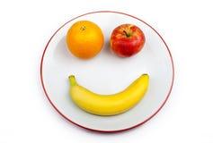 Frutta Smiley Face su un piatto Fotografia Stock Libera da Diritti