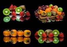 Frutta succosa matura su un fondo nero Immagini Stock