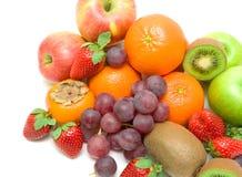 Frutta succosa su un fondo bianco Fotografia Stock