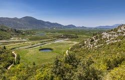 Frutteti e campi agricoli nel neretva Croa di delta del fiume Immagini Stock