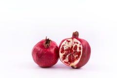 Frutti del melograno su un fondo bianco fotografia stock libera da diritti