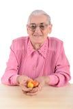 Frutti della donna anziana Fotografia Stock
