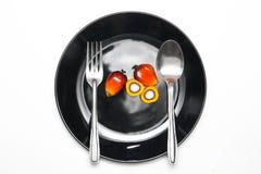 Frutti della palma da olio su un piatto Fotografia Stock Libera da Diritti