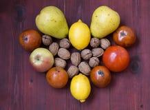 Frutti di inverno sulla tavola di legno Fotografia Stock Libera da Diritti