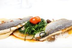 Frutti di mare con il raccordo del branzino su fondo bianco Immagine Stock Libera da Diritti