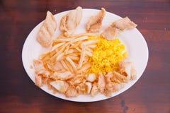 Frutti di mare con le patate fritte ed il riso Immagini Stock Libere da Diritti