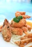 Frutti di mare fritti nel grasso bollente Immagine Stock Libera da Diritti
