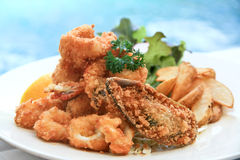 Frutti di mare fritti nel grasso bollente Fotografie Stock