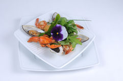 Frutti di mare, mussels crayfish. Tasty seafood, mussels with crayfish on fresh leaves Stock Photography