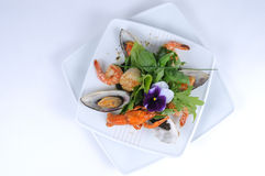 Frutti di mare, mussels crayfish. Tasty seafood, mussels, prawns with crayfish on fresh leaves Royalty Free Stock Image