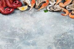 Frutti di mare Polipo, ostriche, aragosta, gamberetti Immagine Stock
