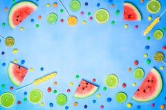 Frutti e dolci su fondo blu Immagine Stock Libera da Diritti