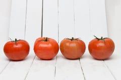 Frutti rossi dei pomodori isolati su bianco Immagini Stock Libere da Diritti