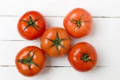 Frutti rossi dei pomodori isolati su bianco Fotografia Stock