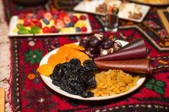 Frutti secchi su un piatto: uva passa, albicocche secche, prugne, churchkhela Immagine Stock Libera da Diritti