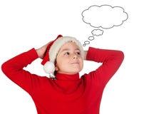 Förvånad unge med att tänka för julhatt Royaltyfria Bilder