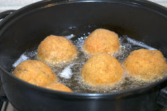 Fry of arancini Royalty Free Stock Images