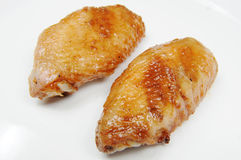 Fry chicken wings. A few delicious chicken wings Stock Photo