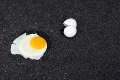 Fry egg pavement Royalty Free Stock Photos
