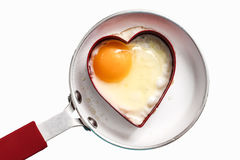 Fry pan with egg in heart shape Stock Image