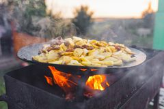 Fry potatoes on open fire in the open air stock photo