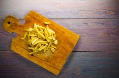 Fry potatoes on a wooden background Royalty Free Stock Image