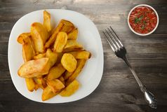 Fry potatoes on a wooden background. Fry potatoes on a plate Stock Photo