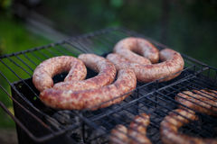 Fry sausages. In the garden Royalty Free Stock Photo
