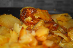 Fry-up potatoes. Frying potaties with onions and cpises Stock Photo