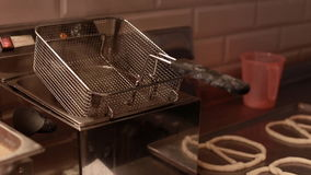 Fryer with steam, close up. Baking buns on the production line in the baking industry,. Selective focus stock video