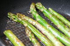 Frying asparagus Royalty Free Stock Images