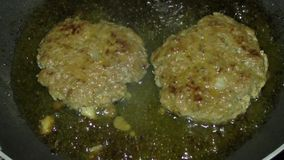 Frying beef burgers in the pan/skillet stock video