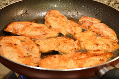 Frying breaded chicken meat Stock Photos