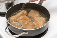 Frying breaded meat Stock Photo