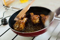 Frying chicken in a pan Stock Images