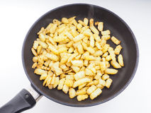 Frying chopped potatoes in a fry pan Stock Photography