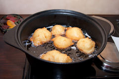 Frying doughnut oil Royalty Free Stock Photo