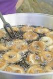 Frying Doughnuts Stock Image