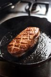 Frying duck breast Stock Images