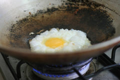 Frying an egg Royalty Free Stock Photography