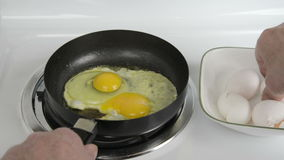 Frying Eggs stock footage