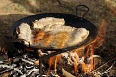 Frying fish Stock Image