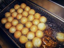 Frying Fish Balls with Oil in a Commercial Deep Fryer. royalty free stock photo