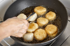 Frying fish cake Stock Images